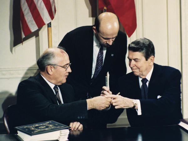 President Ronald Reagan (right) and Soviet leader Mikhail Gorbachev exchange pens during the Intermediate Range Nuclear Forces Treaty signing ceremony in the White House on Dec. 8, 1987. Gorbachev's translator Pavel Palazhchenko stands in the middle.
