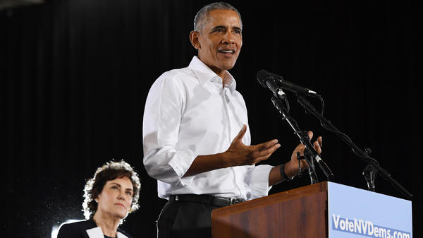 Rep. Jacky Rosen, D-Nevada, looks on as former President Barack Obama speaks during a get-out-the-vote rally as he campaigns for Nevada Democratic candidates on Monday in Las Vegas.