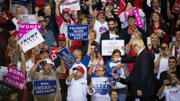 Supporters cheer as President Trump takes the stage for a rally in support of Sen. Ted Cruz, R-Texas, on Monday in Houston.