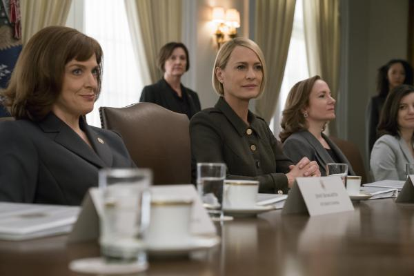 Robin Wright's character Claire Underwood (center) ascends to the presidency in the final season of <em>House of Cards</em>.