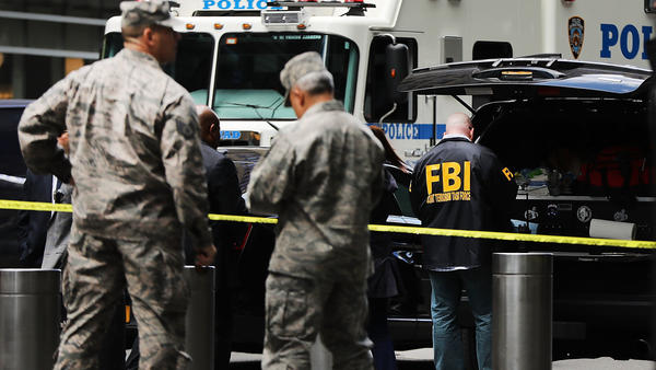 Police, FBI and other emergency workers gather outside the Time Warner Center in New York City after an explosive device was found Wednesday morning at CNN's office in the building.
