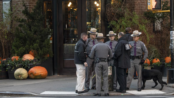 Law enforcement officials gather near Robert De Niro's Tribeca Grill restaurant in New York City after another suspicious package was found early Thursday.