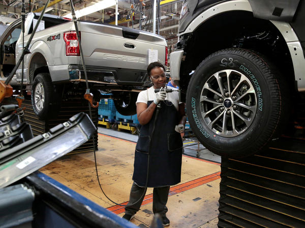 A Ford F-150 pickup is assembled at a plant in Dearborn, Mich., on Sept. 27. The economy expanded at a 3.5 percent rate in the third quarter.