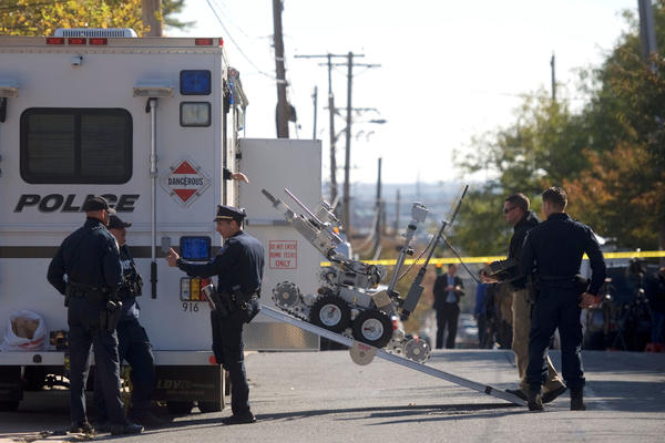Law enforcement personnel operate a bomb disposal robot outside a post office which had been evacuated in Wilmington, Del., on Thursday.