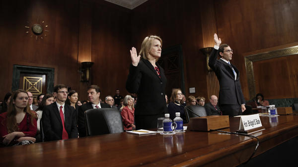 Appellate court nominees Bridget S. Bade and Eric D. Miller are sworn in during a hearing held by the Senate Judiciary Committee on Wednesday. Only two senators — Mike Crapo, R-Idaho, and Orrin Hatch, R-Utah — were in attendance.