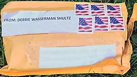 One of the package bombs that was sent to a critic of President Trump is shown. Experts say excessive postage is a key sign of a suspicious package.