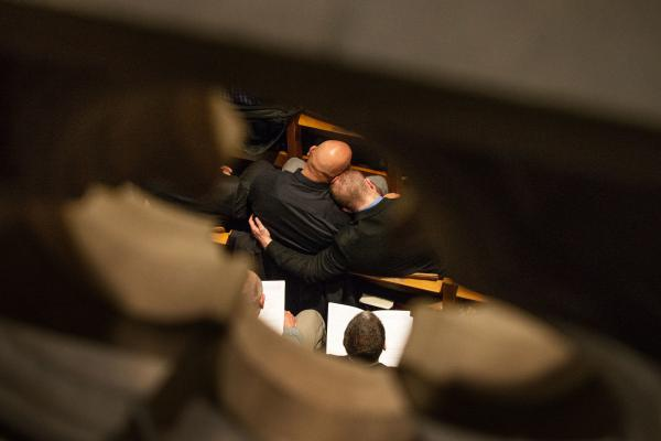 Attendees embrace during the service at the National Cathedral in Washington, D.C. on Friday.