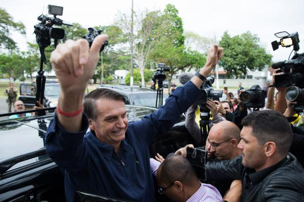 Bolsonaro gives his thumbs-up after casting his vote at Villa Militar in Rio de Janeiro on Oct. 7, in the general election's first round.