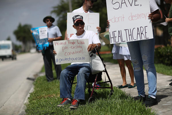 Shelton Allwood joined other demonstrators in Miami last year calling for continued protection for people who have pre-existing medical conditions.