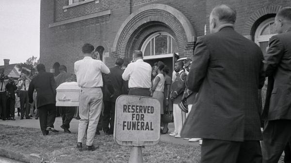 A white casket containing the body of 14-year-old Carol Robertson, one of four young African-American girls killed in the 16th Street Baptist Church bombing by Ku Klux Klan members, is carried in for funeral services in 1963 in Birmingham, Ala.