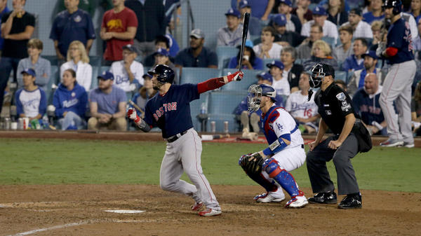 Steve Pearce of the Boston Red Sox hits a three-run double in the ninth inning against the Los Angeles Dodgers in Game 4 of the World Series at Dodger Stadium Saturday.