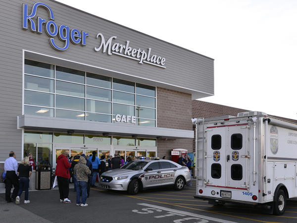 The scene outside a Kroger supermarket following a shooting that left two people dead last Wednesday in Jeffersontown, Ky. Many have labeled the attack a hate crime.