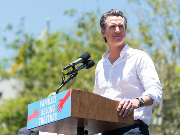 "California Lt. Gov. Gavin Newsom speaks at a ""Families Belong Together"" march in Los Angeles on June 30. Newsom is leading the polls in his campaign for governor."