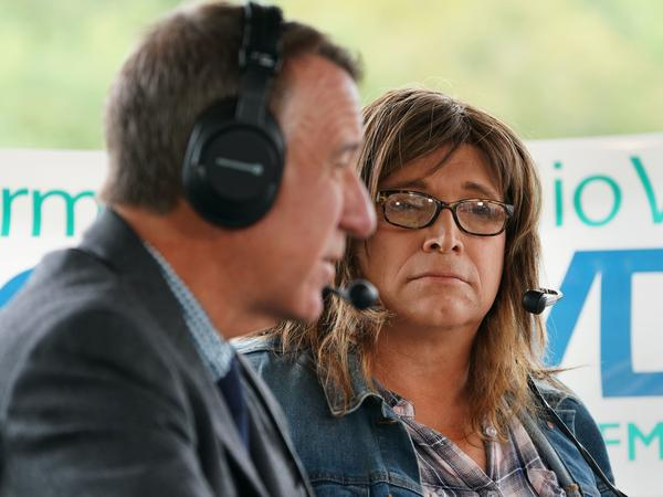 Vermont Gov. Phil Scott and his Democratic challenger, Christine Hallquist, face off in a debate on Sept. 14 at the Tunbridge World's Fair in Tunbridge, Vt.
