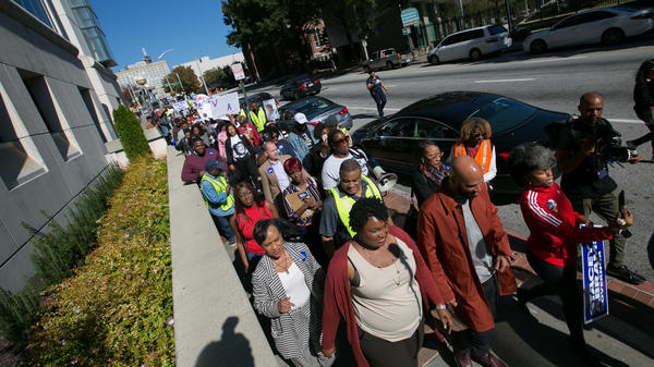 "Democratic Georgia gubernatorial candidate Stacey Abrams and Grammy-winning artist Common lead voters during a ""Souls to The Polls"" march in downtown Atlanta on Oc. 28. The march went from Underground Atlanta to the Fulton County Government Center polling station open for early voting."