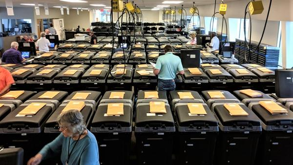 Shawnee County workers check election equipment this summer to make sure it functions correctly.