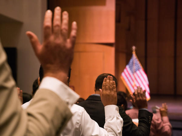 Newly sworn-in U.S. citizens gather for a naturalization ceremony at the Rachel M. Schlesinger Concert Hall and Arts Center in Alexandria, Va., in August. The Trump administration is planning to include a question about U.S. citizenship status on the 2020 census.