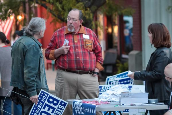 State Rep. Steve Becker, a Republican from Buhler, tries to convince people on the streets of Hutchinson, Kansas to write in his name in the general election.