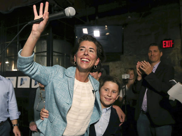Incumbent Democratic Rhode Island Gov. Gina Raimondo waves to supporters alongside her son, Thompson, at her primary night victory party, Wednesday, Sept. 12, 2018.