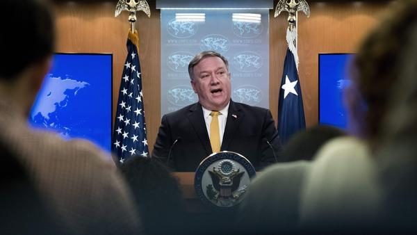 "Secretary of State Mike Pompeo briefs the media last month in Washington, D.C. Pompeo said Friday that the upcoming sanctions snapback aims ""to compel Iran to permanently abandon its well-documented outlaw activities."""