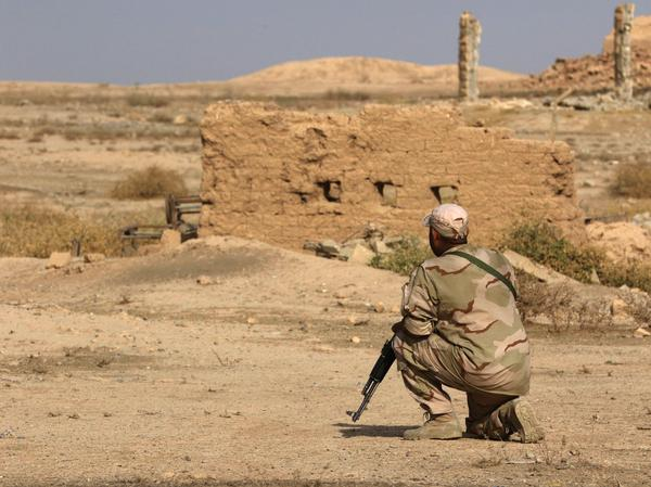 An Iraqi soldier looks at destruction caused by ISIS at the archaeological site of Nimrud in November 2016, a few days after Iraqi forces retook the ancient city.
