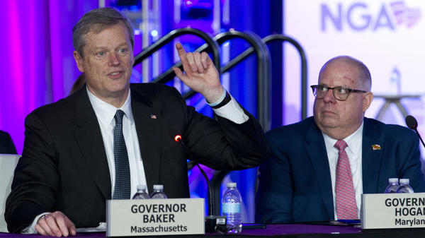 Gov. Charlie Baker, R-Mass., and Gov. Larry Hogan, R-Md., appear at the National Governor Association 2018 winter meeting in February. Despite leading overwhelmingly Democratic states, the two Republicans have positioned themselves well to win reelection on Tuesday.