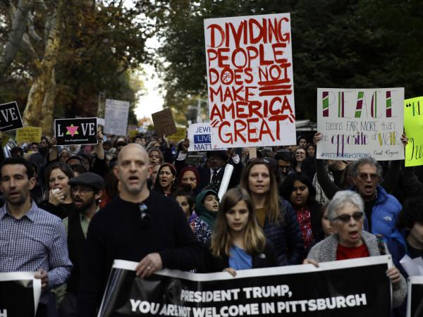 Protesters demonstrate near Pittsburgh's Tree of Life Synagogue where President Trump paid respects on Tuesday. The shooting there and heated reactions to it added to the anxiety leading up to the midterm vote.