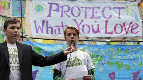 The climate change lawsuit inspired this rally in Seattle, along with ones in Portland and Eugene, Ore.