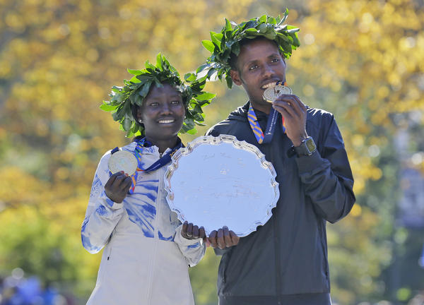 First place finishers Mary Keitany of Kenya, left, and Lelisa Desisa of Ethiopia pose for a picture at the finish line of the New York City Marathon on Sunday.