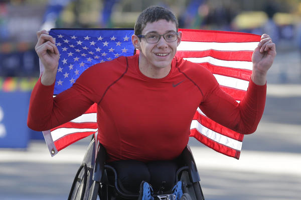 Daniel Romanchuk of the United States poses for a picture after crossing the finish line first in the men's wheelchair division.