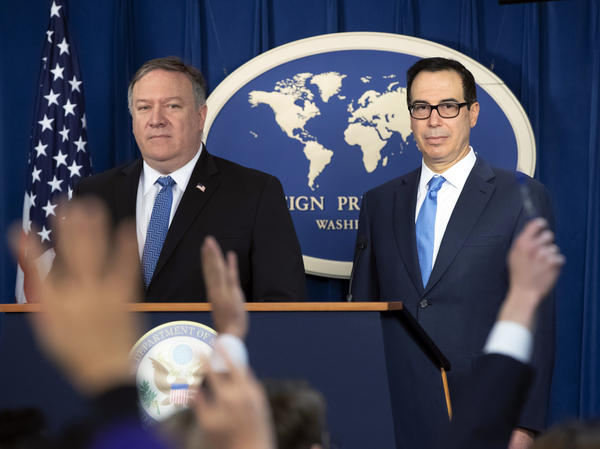 Secretary of State Mike Pompeo (left) and Treasury Secretary Steven Mnuchin present details of renewed U.S. sanctions on Iran at the Foreign Press Center in Washington, D.C., on Monday.