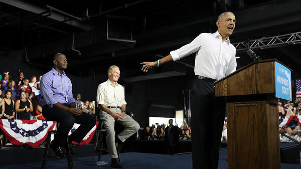 Former President Barack Obama speaks during a rally to support Florida Democratic gubernatorial candidate Andrew Gillum (left) and Sen. Bill Nelson, D-Fla., on Friday in Miami.