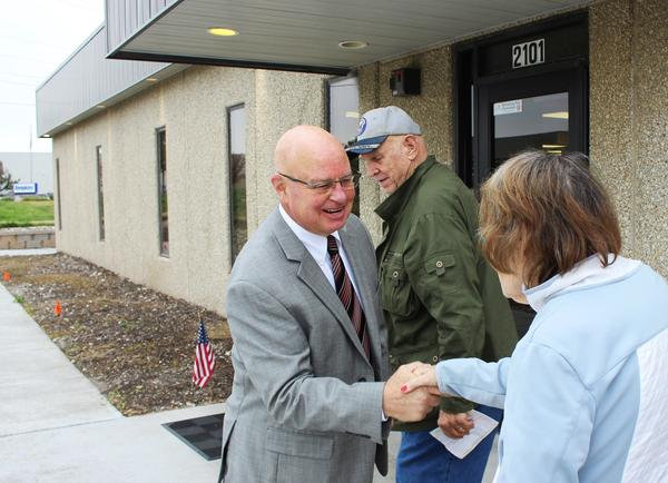 Johnson County Election Commissioner Ronnie Metsker greets early voters at the election headquarters in Olathe, Kansas.