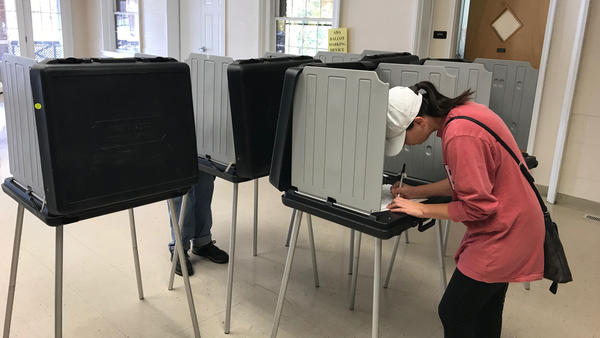 Jessica Miller votes at a polling place in Springfield.
