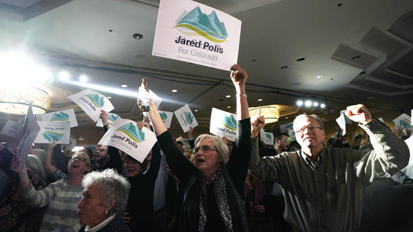 Gov.-elect Jared Polis' supporters cheer him during an election night rally in Denver. Polis defeated Republican state Treasurer Walker Stapleton to become the first openly gay man elected governor in the U.S.