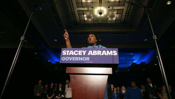 Stacey Abrams addresses her supporters at an election watch party early Wednesday in Atlanta. She and her opponent, Republican Brian Kemp, are locked in a gubernatorial race that remains too close to call.