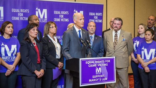 Governor Rick Scott speaks on behalf of Marsy's Law in Florida at an event in March..