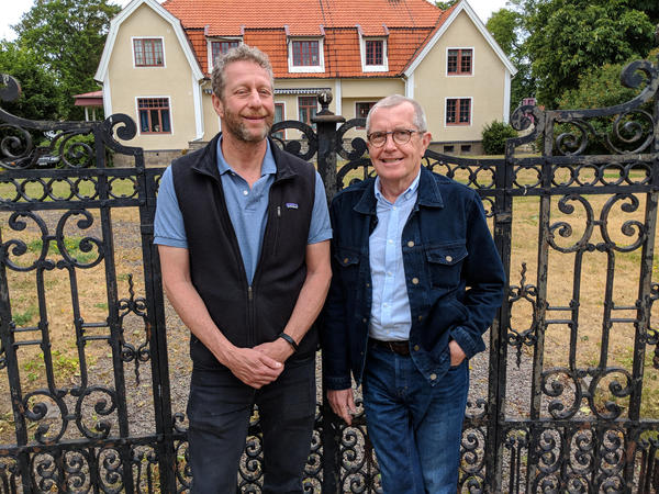 Uri Berliner stands with Swedish journalist Claes Furstenberg in front of the former Furstenberg family home in Kalmar, Sweden.