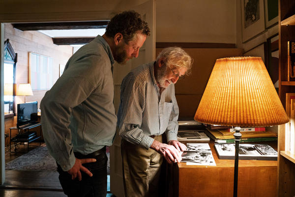 Uri and his father, Gert, look through old photographs in Gert's Manhattan apartment. Gert became a photographer and painter when he came to the U.S.