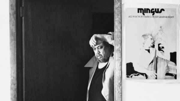 Charles Mingus poses next to a poster for his six nights of performances at the Strata Concert Gallery in Detroit in 1973. A recording of one of those nights has just been released.