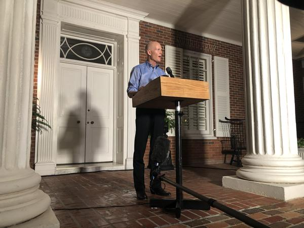 Gov. Rick Scott held a press conference outside the governor's mansion in Tallahassee on Thursday night.
