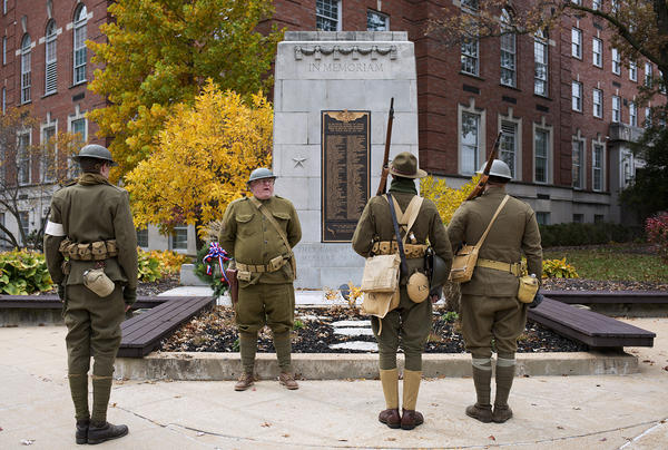 Thomas Hoff, a museum educator with St. Louis County Parks, speaks during a wreath-laying ceremony to honor veterans at the World War I memorial in downtown Clayton on Friday.