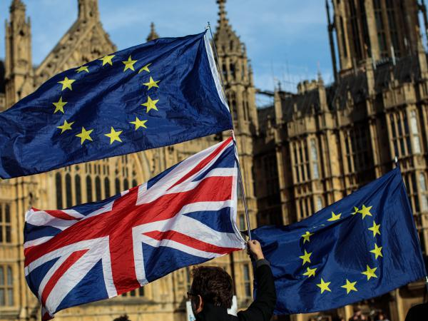 Demonstrators gather Tuesday to protest Brexit outside Parliament in London. They wave the Union Jack and the flag of the European Union.