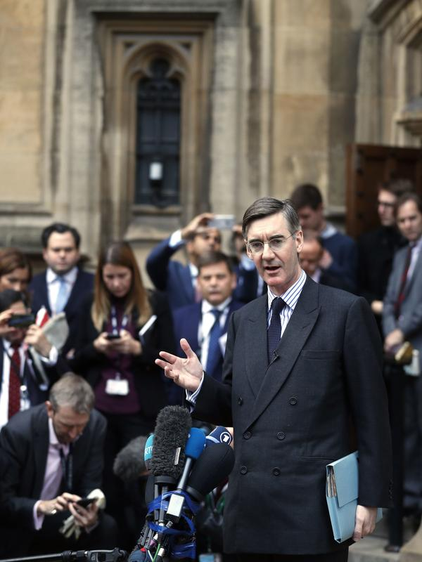 Jacob Rees-Mogg, leader of the hard-line pro-Brexit European Research Group, speaks to the media Thursday outside the Palace of Westminster. The Conservative lawmaker requested a vote of no-confidence in Prime Minister Theresa May.