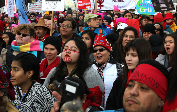 People listen to speakers raising awareness about missing and murdered Indigenous women at a rally at Cal Anderson Park in Seattle prior to the Women's March on January 20. A new report examines missing and murdered Indigenous women in cities, not on reservations, and found local law enforcement agencies often do not adequately track such crimes.