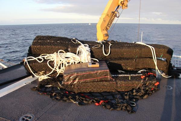 Bales of cocaine are stacked on the deck of the U.S.Coast Guard Cutter James on Oct. 19.