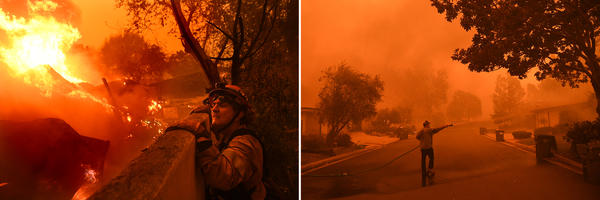 Rick Mullen, who is the mayor of Malibu and a firefighter, surveys a house that is on fire as the Woolsey Fire comes down the hill.