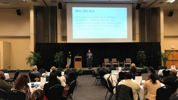 Heather Hausenblas (left) and Timothy Burrows (right) from the Mayor's Council on Fitness and Wellbeing speaking at Humana's third annual Clinical Town Hall.