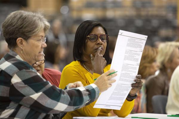Volunteers look at ballots during a hand recount in Palm Beach, Florida. The recount decided the election in favor of the Republican candidates for Senate and governor but election experts warn that similar problems could crop up again in 2020 if the state doesn't address them immediately.