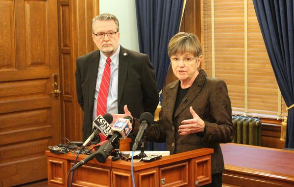 Governor-elect Laura Kelly, with her lieutenant governor Lynn Rogers, says she won't be wasting time or taxpayer dollars on partisan fights.